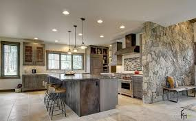Wonderful Grey Stone Wall Ideas For Chic Kitchen With Rustic Wooden Cabinet And Island Amusing Iron Bar Stools Also Stunning Chandeliers