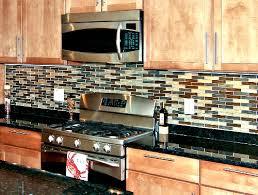 butterfly green granite kitchen countertops with tile backsplash