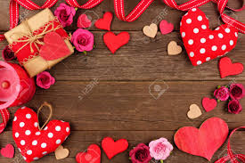 Valentines Day Frame Of Hearts Gifts Flowers And Decor Against A Rustic Wood Background