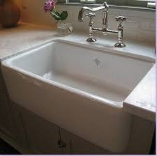 Installing Sink Strainer In Corian by Coriancountertops With Farm House Sink Inset Farmhouse Sink With