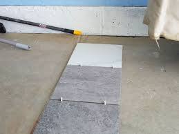 Thinset For Porcelain Tile On Concrete by Our New White And Gray Porcelain Tile Garage Floor Installation