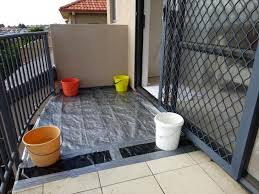 re tile and waterproofing of an existing tiled balcony 158288