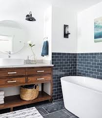 The Bathing Space In This Rustic Bathroom Is Highlighted With Navy Subway Tiles