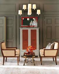 cozy luxe dining room with gold pendant light and orange velvet