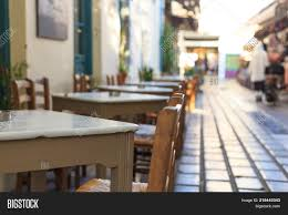 Athens, Greece. Greek Image & Photo (Free Trial) | Bigstock Tables Old Barrels Stock Photo Image Of Harvesting Outdoor Chairs Typical Outdoor Greek Tavern Stock Photo Edit Athens Greece Empty And At Pub Ding Table Bar Room White Height Sets High Betty 3piece Rustic Brown Set Glass Black Kitchen Small Appealing Swivel Awesome Modern Counter Chair Best Design Restaurant Red Checkered Tisdecke Plaka District Tavern Image Crete Greece Food Orange Wooden Chairs And Tables With Purple Tablecloths In