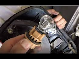 how to replace a brake light and light bulb on a 2008 nissan
