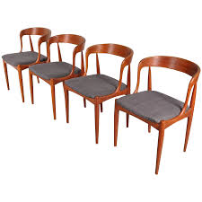 Set Of Four Dining Chairs By Johannes Andersen, Denmark, Circa 1950 Four Ding Chairs In Stain Beech Teak Upholstered With Black Leatherette Art Nouveau Or Deco Shield Back Antique Ding Chairs Set Of Vintage Four By Helge Sibast For Early 19th Century Round Bdmeier Table Moes Home Collection Calvin Sadlers Johannes Andersen Denmark Circa 1950 Victorian Walnut The Shop Fashionchrystal Setfour Includedtransparent 5 Pc Counter Height Room Setpub And 4 East West Fniture Mid Modern Lawrence Peabody