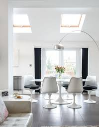 White Modern Dining Room With Arch Floor Lamp