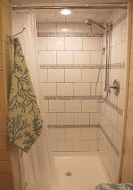 shower with horizontal stripes of biltmore mosaic and white
