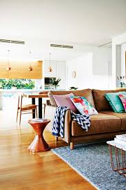 sofa white walls light wooden flooring colourful