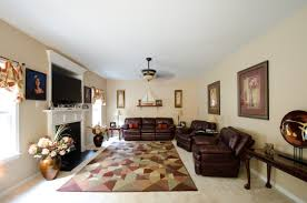 Furniture White Fireplace Connected By Dark Brown Leather Sofa Set And Rug On The