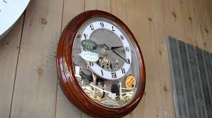 Rhythm Musical Wall Clock With Moving Dial Pendulum And Swarovski 4MJ854WD06
