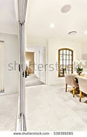 Modern Dining Room Hallway With Entrance To Other Side Including A Glass Window Near Table