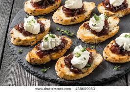 canapes aperitif canape crostini on slate board ideal stock photo 488609953