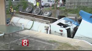 Crash Leaves Septic Truck Upside-down In Backyard Pool