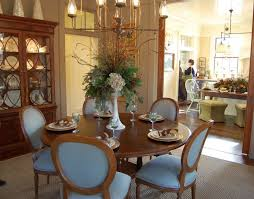 Elegant Dining Room With Traditional Style Decoration Featuring Brown Laminated Wooden Round Table White