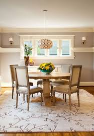 Dinning RoomsGorgeous Dining Room With Round Wood Table And Rustic Chairs On White