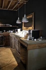 Handsome Rustic Industrial Kitchen With Black Walls Concrete Counters