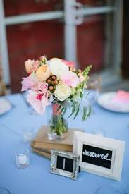 romantic spring wedding pink and white wedding center pieces wood