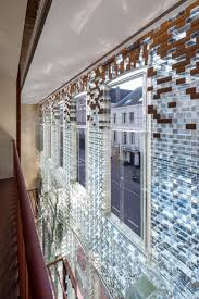 100 Glass Floors In Houses MVRDVs Transparent Brick Store In Amsterdam Reopens For Herms