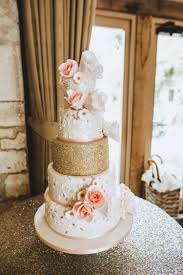 The Wedding Cake Perfectly Matched Color Scheme With Peachy Pink And Gold Glitter