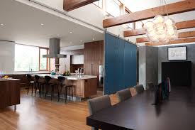 Great Separation Between Kitchen And Dining Room Using Krownlabs Modern BALDUR Sliding Door Hardware Krownlab Architecture