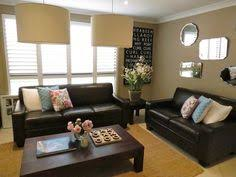Brown Couch Decor Ideas by How To Decorate Around Choc Brown Leather Sofas For The Home