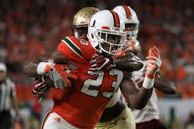 Chris Herndon Says Get Off Me To A Seminole Photo By Mike Ehrmann Getty Images