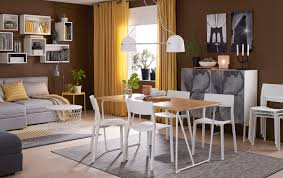 A Medium Sized Dining Room Furnished With Table In Bamboo White Legs