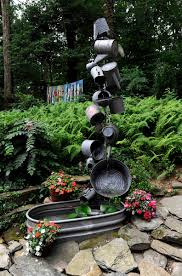 Baltimore County Christmas Tree Disposal by Recycling Found Objects Into Garden Art