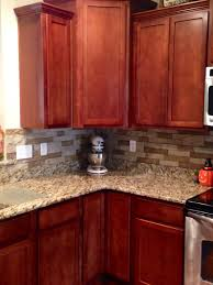 Kitchen Paint Colors With Light Cherry Cabinets by What Countertop Goes With Cherry Cabinets Color Backsplash Ideas