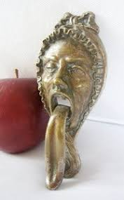 Antique door knocker woman with huge tongue Boing Boing