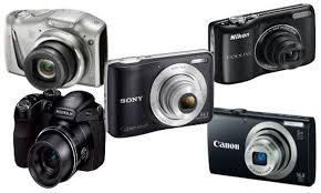 3 appareils photo numériques nikon à la loupe objectif photographe