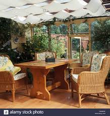 Wicker Chairs And Simple Wooden Table In Conservatory Dining ... Rattan Ding Chair Set Of 2 Mocka Nz Solid Wood Table Wicker Chairs Garden Table And Chairs 6 Seater Triple Plate Grey Granite Wicker Grosseto Cream Wood Round With 5 In Blandford Forum Dorset Gumtree Teak Driftwood Sunbrella Details About Louis Outdoor 7 Piece Acacia Stacking Shore Coastal Cushion Room Trends Ideas For 20 Hayneedle Sahara 10 Seat Top Kai Setting Sicillian Stone Half Rovicon Saltash Small Extending 4 Amari 1