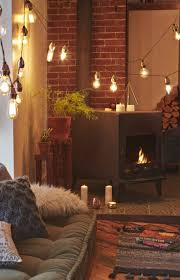living room with wood stove cozy warm lights