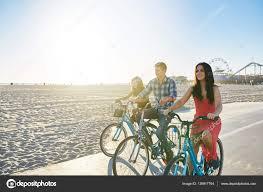 Three Friends Riding Bikes Stock Photo