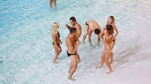 Group Of Young People Dancing In Swimming Pool Stock Video Footage