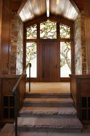 Rustic Foyer Ideas Entry With Ceiling Lighting Door Rock Wall
