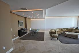 living room low ceiling lights white painted wall rectangle brown