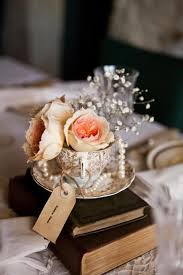 Vintage Wedding Table Centrepiece Using Teacup Old Books Pearls And Handmade Tags