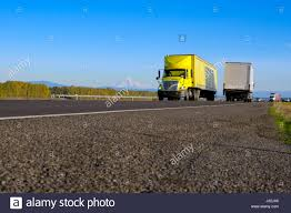 Modern Bright Yellow Semi Truck With Yellow Trailer On The Scenic ...
