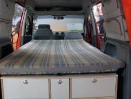 A Cozy Twin Bed In Mini Camper Van Conversion