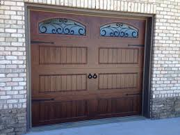 Clopay Walnut Finish Gallery Collection Garage Doors With Arched Wrought Iron Windows And Decorative Hardware