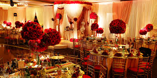 Table Decorations For Wedding Reception With Red Flowers In Glass Stand Vases And Small Candles Holders