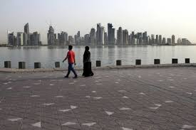 In This Friday May 4 2018 Photo A Couple Walk By The Sea With City Skyline Background Doha Qatar Diplomatic Crisis Gripping