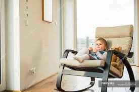 Girl Sitting In Rocking Chair Using Smartphone — Color Image ... Happy Calm African Girl Resting Dreaming Sit In Comfortable Rocking Senior Man Sitting Chair Homely Wooden Cartoon Fniture John F Kennedy Sitting In Rocking Chair Salt And Pepper Woman Sitting Rocking Chair Reading Book Stock Photo Grandmother Her Grandchildren Pensive Lady Image Free Trial Bigstock Photos Hattie Fels Owen A Wicker Emmet Pregnant Young Using Mobile Library Of Rocker Free Stock Png Files