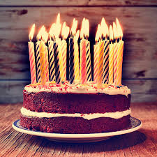 birthday cake with some lit candles filtered stock photo