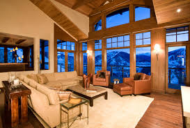 An amazing earth tone colored living room with snow capped