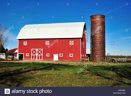 A Modern Red Barn Topped By A Corrugated Steel Roof With An ... Red Barn With Silo In Midwest Stock Photo Image 50671074 Symbol Vector 578359093 Shutterstock Barn And Silo Interactimages 147460231 Cows In Front Of A Red On Farm North Arcadia Mountain Glen Farm Journal Repurpose Our Cute Free Clip Art Series Bustleburg Studios Click Gallery Us National Park Service Toys Stuff Marx Wisconsin Kenosha County With White Trim Stone Foundation Vintage White Fence 64550176
