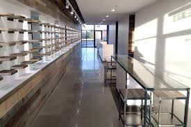 Project Log Contemporary Retail Space With Reclaimed Wood Feature Wall Display Shelves Anthology Woods